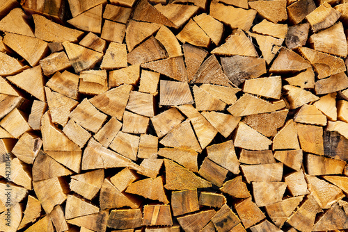 Poster Firewood texture Woodpile in stack.Triangle shape. Wall of firewood