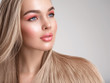 canvas print picture Portrait of a blonde beautiful woman with a long straight light hair. Portrait of a beautiful woman with a coral color makeup. Beautiful female face. Fashion model.