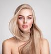 Leinwandbild Motiv Portrait of a blonde beautiful woman with a long straight light hair. Portrait of a beautiful woman with a coral color makeup. Beautiful female face. Fashion model.