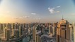 Dubai Marina skyscrapers and jumeirah lake towers panoramic view during sunrise from the top aerial morning timelapse in the United Arab Emirates. Traffic on roads