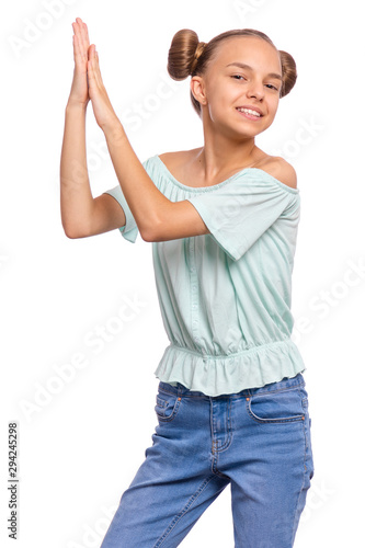 Emotional portrait of caucasian smiling teen girl clapping hands Canvas Print
