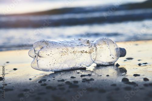 Obraz na plátně  land and sea pollution pollution, ecological problem, used plastic bottle on sea
