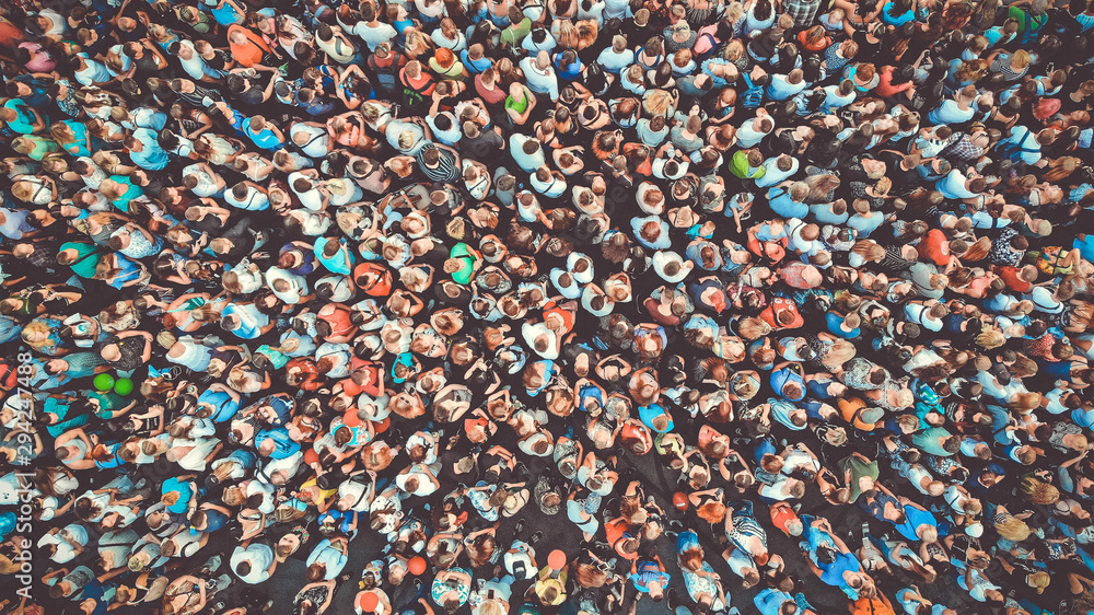 Fototapeta Aerial. People crowd background. Mass gathering of many people. Top view. Toned.