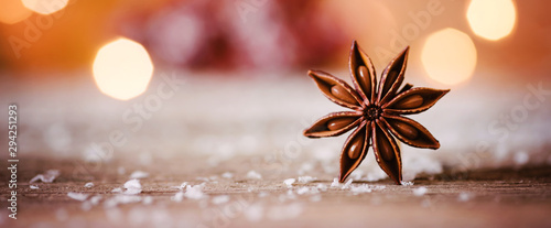 Fototapeta Christmas themed banner or header with a closeup shot of star anise with warm and cozy winter background and copy space obraz