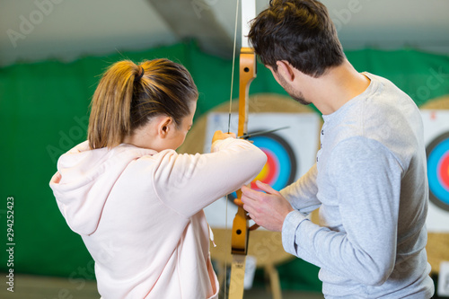 Photo portrait of people and archery center