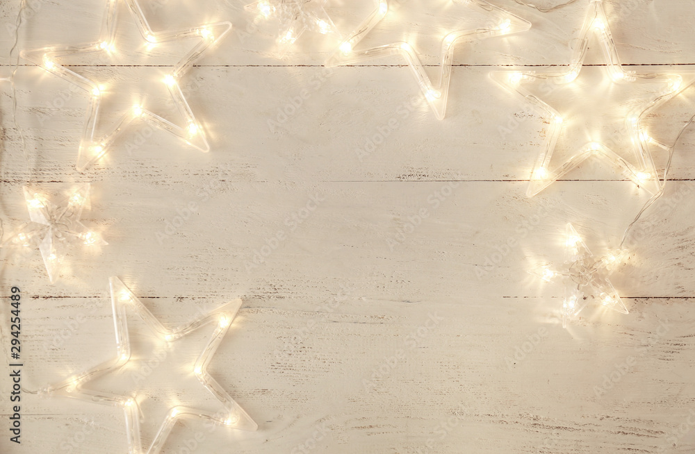 Fototapety, obrazy: Beautiful glowing garland on white wooden background