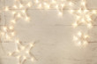 canvas print picture - Beautiful glowing garland on white wooden background