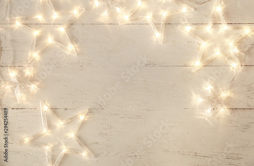 Beautiful glowing garland on white wooden background - 294254489