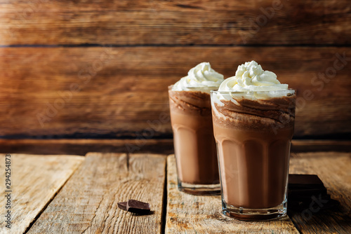 Spoed Foto op Canvas Chocolade Dark hot chocolate with whipped cream
