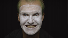 Clown Halloween Man Portrait. Close-up Of An Evil Clowns Face. White Face Makeup