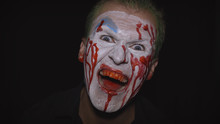 Clown Halloween Man Portrait. Creepy, Evil Clowns Blood Face. White Face Makeup