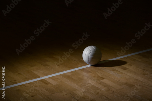 Photographie Volleyball court wooden floor with ball on black with copy-space