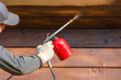 Woodworking with a protective coating using a spray gun