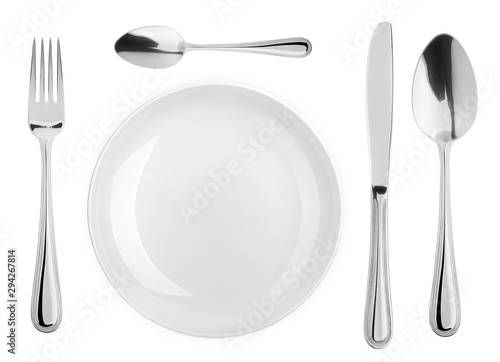 Fototapeta Empty plate, Spoon, teaspoon, fork, knife, cutlery isolated on white background, clipping path, top view obraz