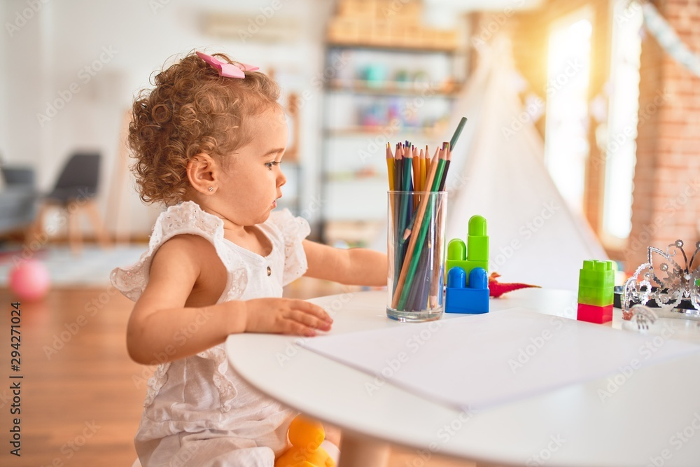 Fototapety, obrazy: Beautiful caucasian infant playing with toys at colorful playroom. Happy and playful drawing with color pencils at kindergarten.