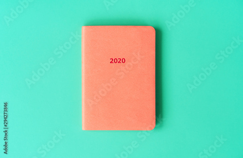 Orange diary for 2020 with artificial leather cover on a mint background Canvas Print