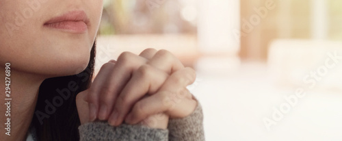 Young asian woman praying, teen prayer, hope, gratitude concept Slika na platnu