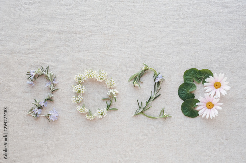2020 made from tiny blossoms flowers and leaves, Happy New Year wellness decoration concept