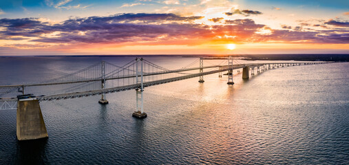 Aerial panorama of Chesapeake Bay Bridge at sunset. The Chesapeake Bay Bridge (known locally as the Bay Bridge) is a major dual-span bridge in the U.S. state of Maryland.