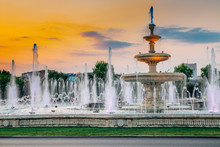 Fountains With Sunset At Unirii Square In Bucharest, Romania