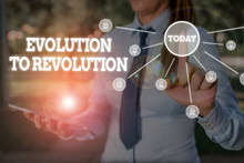 Writing Note Showing Evolution To Revolution. Business Concept For Adapting To Way Of Living For Creatures And Huanalysiss Woman Wear Formal Work Suit Presenting Presentation Using Smart Device