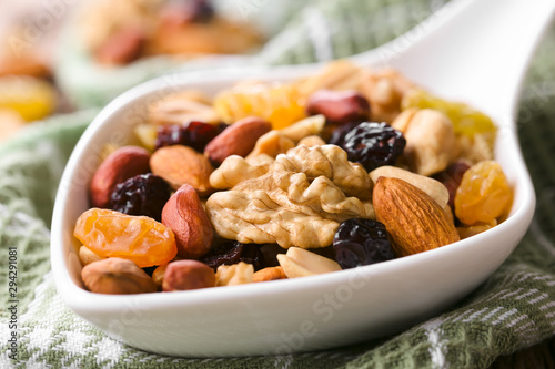 Photo Healthy trail mix snack made of nuts (walnut, almond, peanut) and dried fruits (