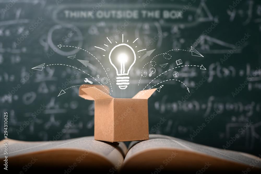 Fototapeta think outside the box on school green blackboard . startup  education concept. creative idea. leadership.