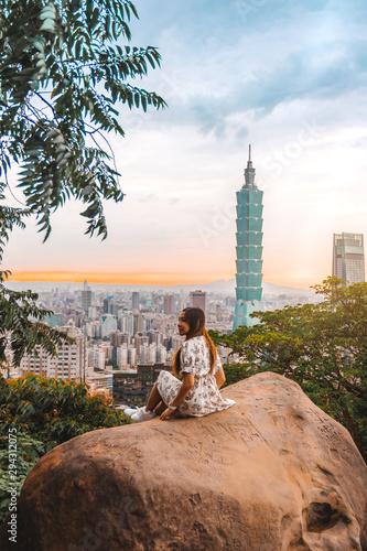 Traveler women and sunset with view of skyline of Taipei cityscape Taipei 101 bu Canvas Print