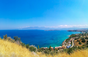 Panoramic view of Mikronisi, Agios Nikolaos, Crete. Beautiful bay view with blue sea and islands. Panorama on Crete island. Destinations for holidays Greece.