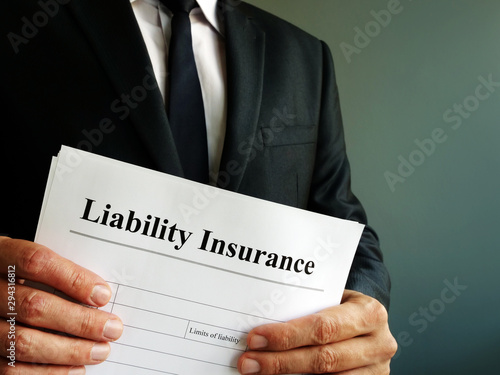 Photo sur Toile Nature Liability Insurance policy in the hands of manager.