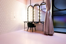 Classy Pink Beauty Cosmetic Makeup Room Or Dressing Fitting Room Backstage Included Light Bulb Mirrors Desk, Luxury Pink Curtain And Green Couch Seat Furniture Decoration Interior For Celebrities