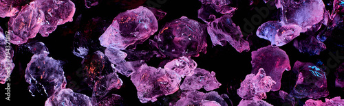 Cuadros en Lienzo  panoramic shot of transparent ice cubes with purple illumination isolated on bla