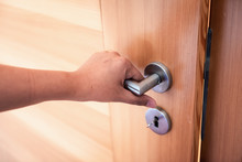 Woman Hand Is Holding Door Knob While Opening A Door In Bedroom, Lock Security System And Access Safety Of Doorway., Interior Design Of Doorknob Entering To Accessibility Private Room