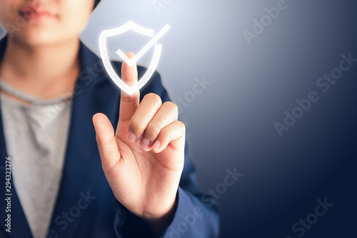 Fototapeta Certified Guarantee Approval or Secure Access System Concept, Business Woman is Pressing Identity Proofing Icon for Security Protection Systems on Screen