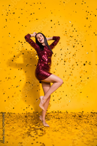 Vertical full length body size view of nice attractive lovely glamorous gorgeous smart slim fit cheerful girl dancing having fun leisure isolated on bright vivid shine vibrant yellow color background - 294326485