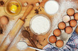 Food ingredients for baking: flour, eggs, milk, sugar
