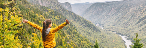 Happy hike travel woman with open arms outstretched in happiness carefree enjoying fall autumn panoramic banner background Fototapete