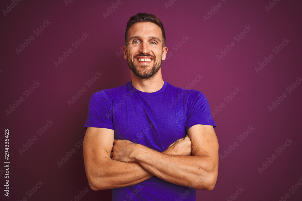 Fototapety, obrazy: Young man wearing casual purple t-shirt over lilac isolated background happy face smiling with crossed arms looking at the camera. Positive person.
