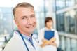 Leinwandbild Motiv Smiling senior physician with competence and success