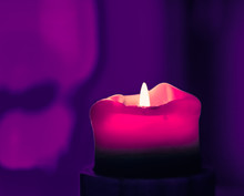 Pink Holiday Candle On Purple ...