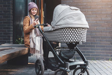 Woman With Baby Stroller Walki...