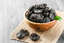 Fresh Prunes In Wooden Bowl. P...
