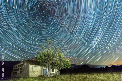 Star trails with shooting stars on a country house Canvas Print
