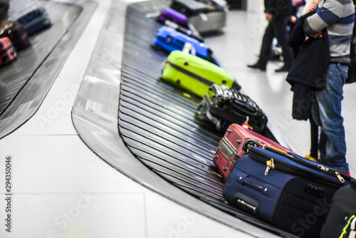 Fotografie, Obraz  Suit case conveyor belt at airport baggage to claim.