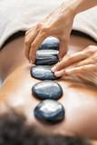 Fototapeta Kamienie - Hot stone massage at spa