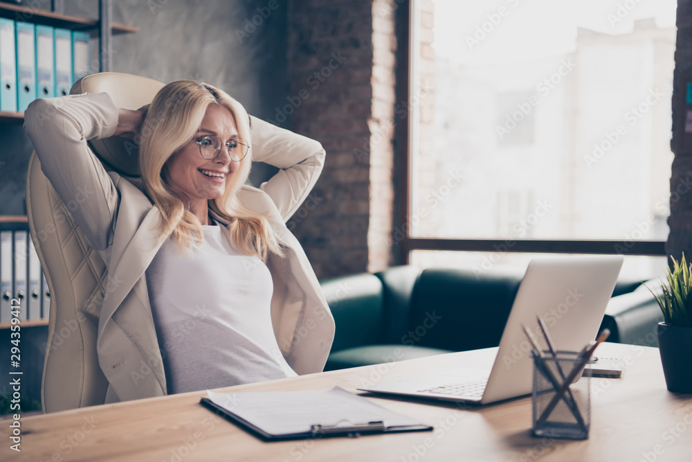 Fototapeta Photo of excited cheerful ecstatic woman working in front of her laptop with project finished and salary received according to annual income