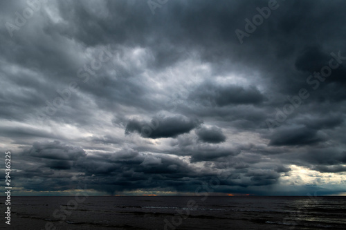 Deurstickers Grijs Dark clouds over Baltic sea.