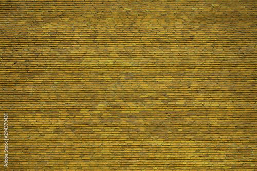 Rustikale Backsteinwand als Hintergrund mit gelber Farbe