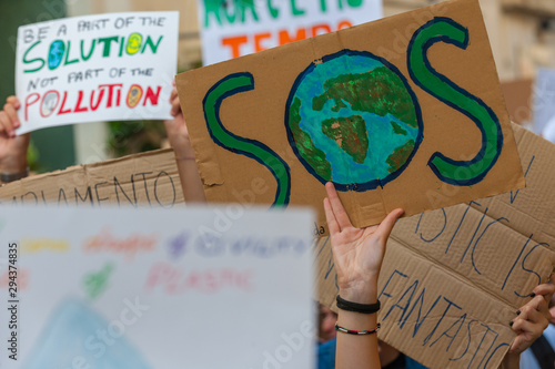 Fridays for future: students hands showing  banners and boards Fototapeta