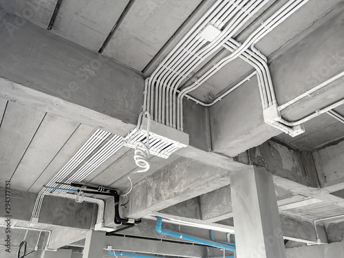 Obraz Installation of electrical wiring on the ceiling.Electrical cable system installation. - fototapety do salonu